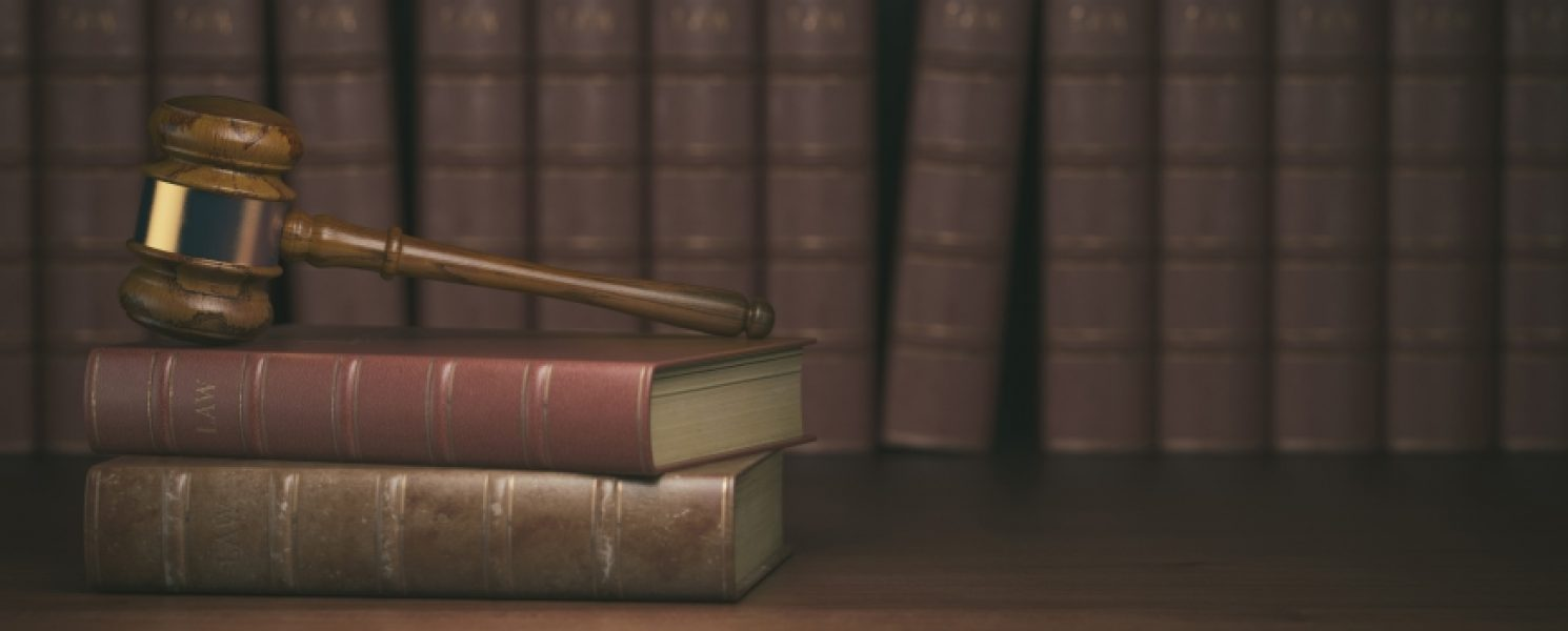 gavel-on-the-background-of-vintage-lawyer-books-PVBWXFL-870x432